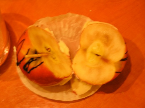 A metaphor for the cruise industry: an apple that we got from the 'Chocaholic Buffet' was beautifully dipped in chocolate, but when we cut it open it was rotten inside.